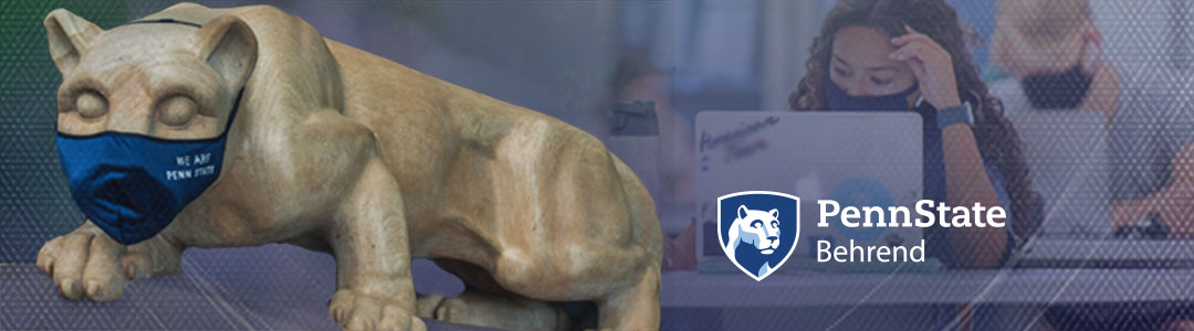 Penn State Behrend. Penn State Nittany Lion Shrine wearing protective mask. Masked Students in campus computer lab in background.