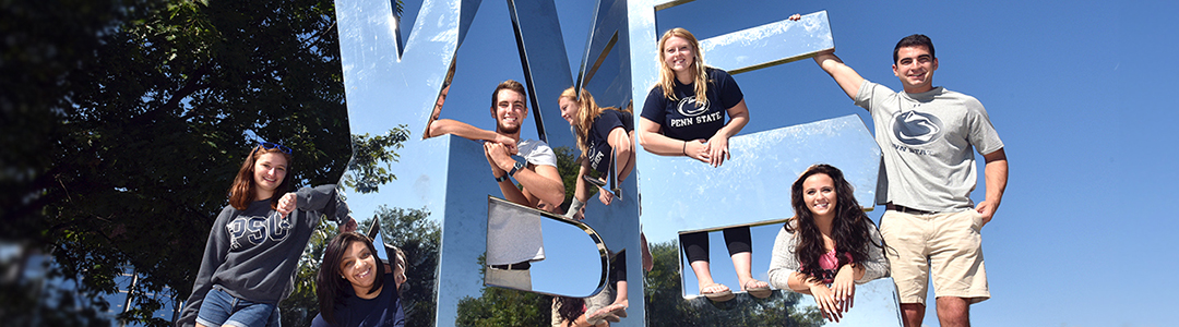 Penn State Students at iconic We Are sculpture.