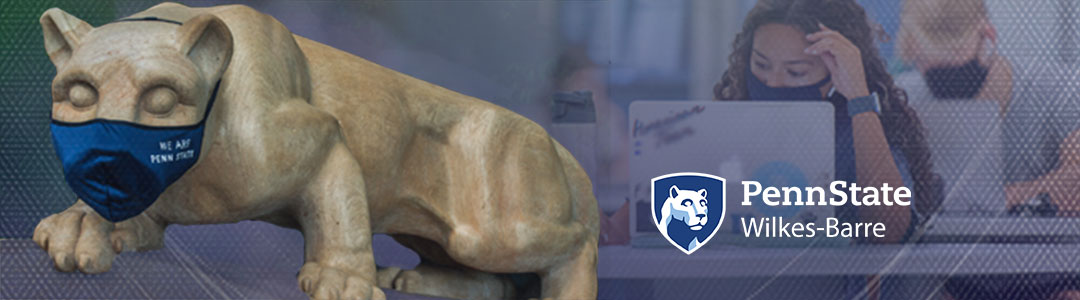 Penn State Wilkes-Barre. Penn State Nittany Lion Shrine wearing protective mask. Masked Students in campus computer lab in background.